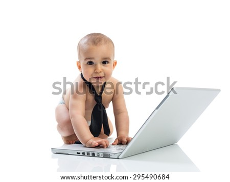 Baby and computer isolated on white - stock photo