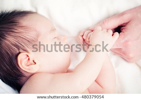 Baby and Dad, Newborn and his Father's Hand