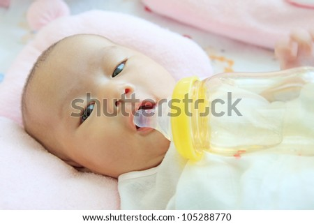 baby and drinking water bottle - stock photo