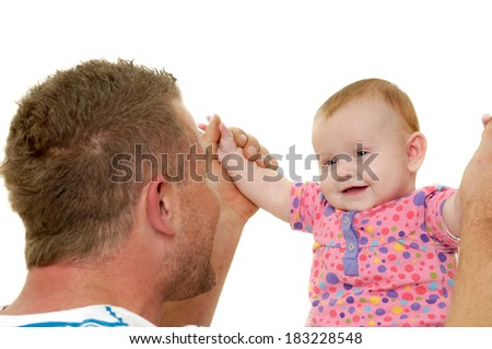 Baby and father are playing. They are both smiling and are very happy together.  The baby 3 month old. Isolated on a white background. - stock photo