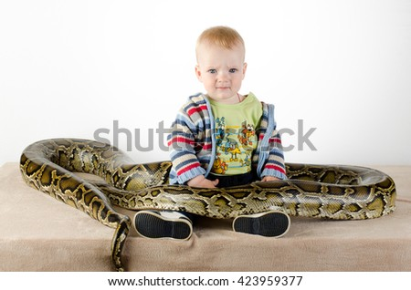 Baby and giant snake - best friend