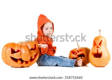 Baby and Halloween pumpkins. Isolated on white background