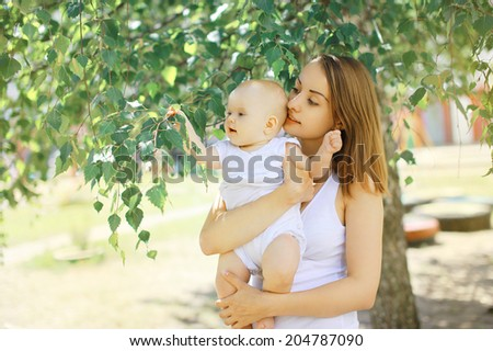 Baby and mother summer - stock photo