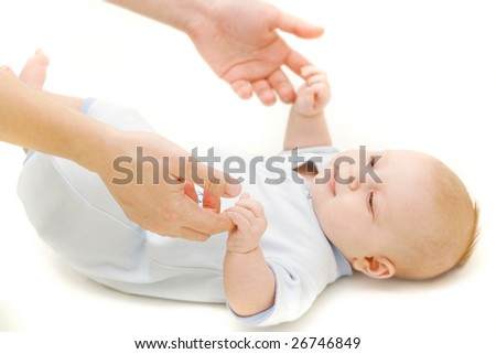 baby and parent's hands over white - stock photo