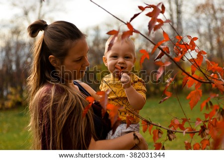 Baby and red leaf
