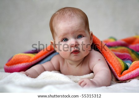 baby and the towel - stock photo