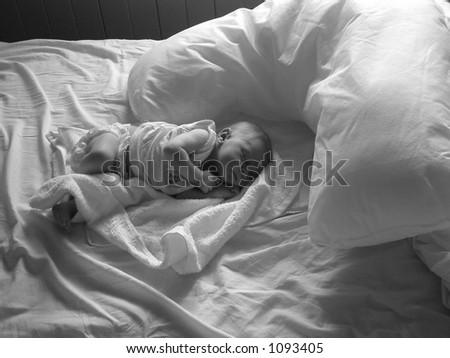 baby asleep on bed - stock photo