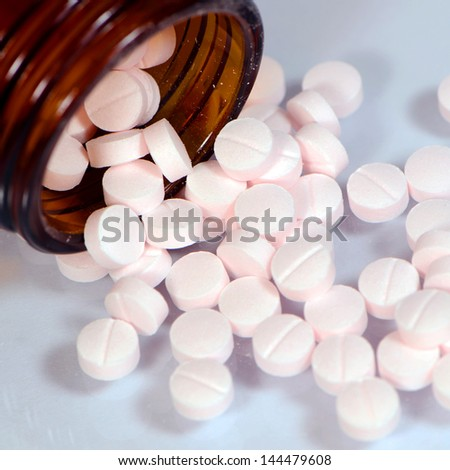 Baby Aspirin Compress Tablets. - stock photo