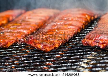 Baby back ribs prepared in smoker. - stock photo