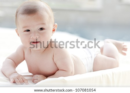 Baby bathing in light - stock photo