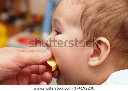 Baby bites fed him a slice of apple
