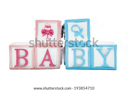 Baby blocks against a white background - stock photo