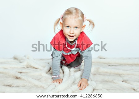 Baby blond girl crawling on coverlet. Girl opened her mouth - stock photo