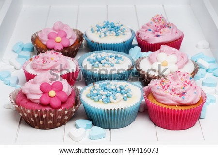 baby blue and pink cupcakes - stock photo