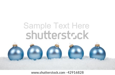 Baby blue Christmas ornaments/baubles on a white background with copy space - stock photo