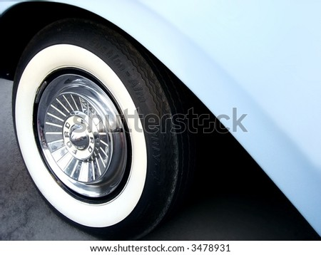 baby blue classic car wheel well - stock photo