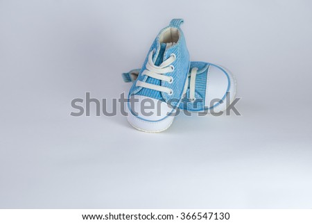 baby booties; blue; footwear - stock photo