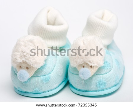 Baby boots with hedgehogs - stock photo