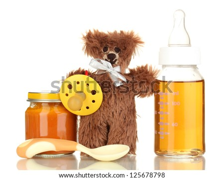 Baby bottle with fresh juice, puree and teddy bear isolated on white - stock photo