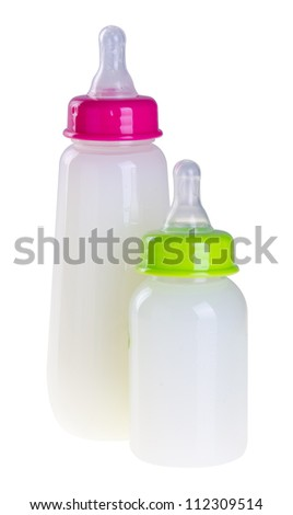 Baby bottle with milk on the background - stock photo
