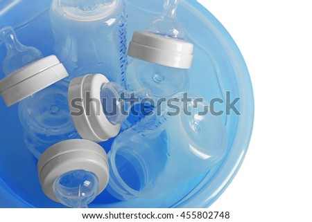 Baby bottles in plastic blue basin