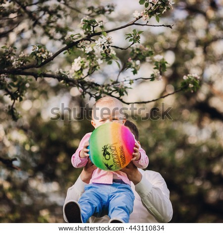 Baby boy and colorful ball - stock photo