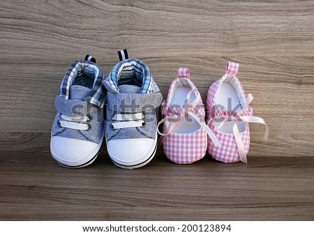 Baby boy and girl shoes - stock photo