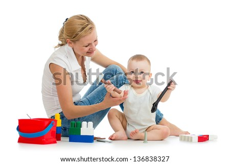 baby boy and mother playing toy