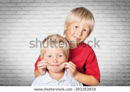 Baby, boy, brother. - stock photo