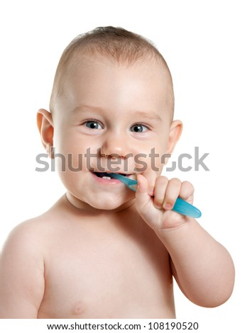 Baby boy cleaning his teeth. White background. - stock photo