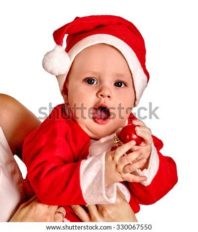 Baby boy clothing for Santa hats holding Christmas ball. Isolated. - stock photo
