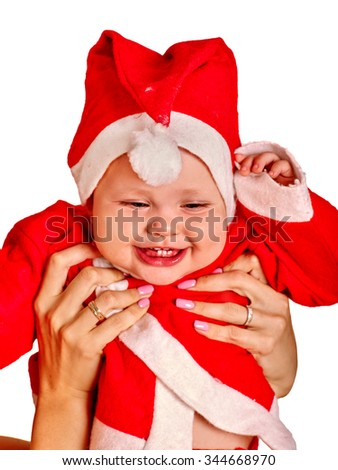 Baby boy clothing for Santa hats holding on mother hands. Isolated. - stock photo