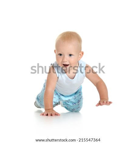 Baby boy crawling on floor on white background