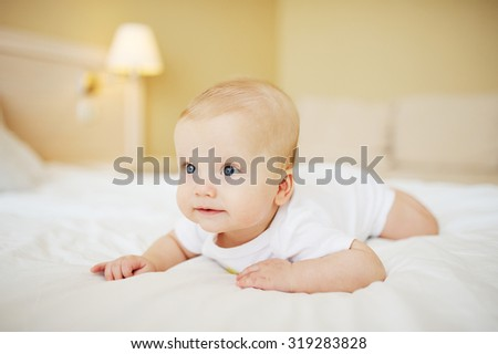 baby boy crawling on the bed