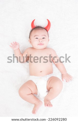 baby boy dressed as a devil - stock photo
