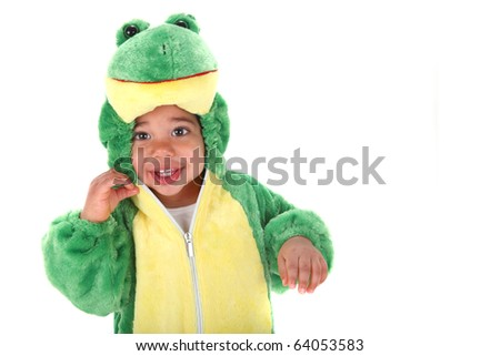 Baby boy dressed in a frog costume