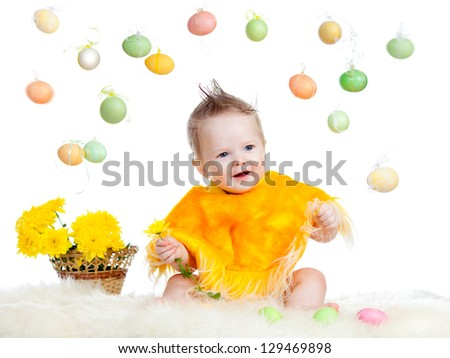 baby boy dressed in Easter chicken costume - stock photo