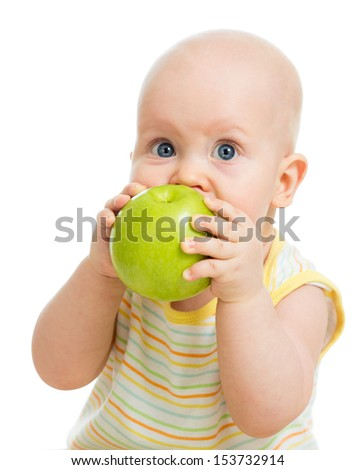 Baby boy eating green apple, isolated on white - stock photo