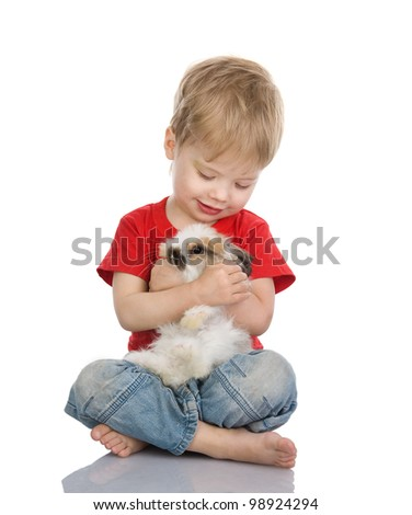 baby boy embraces easter rabbit. isolated on white background - stock photo