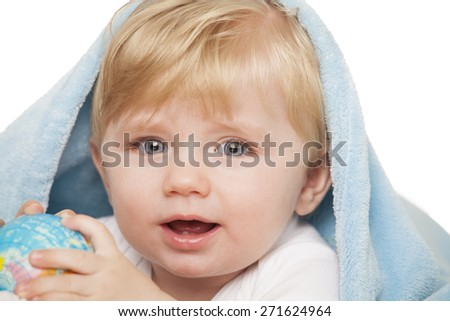 Baby boy holds small globe in his hands. Isolated on a white  - stock photo