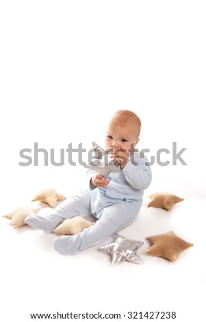 Baby boy in a blue suit with stars, the little prince on a white background