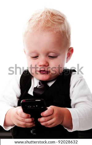 Baby boy in business suit playing with a telephone