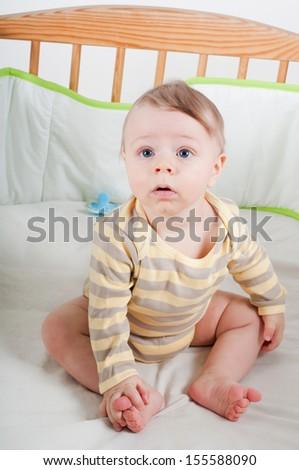 Baby boy in cradle - stock photo