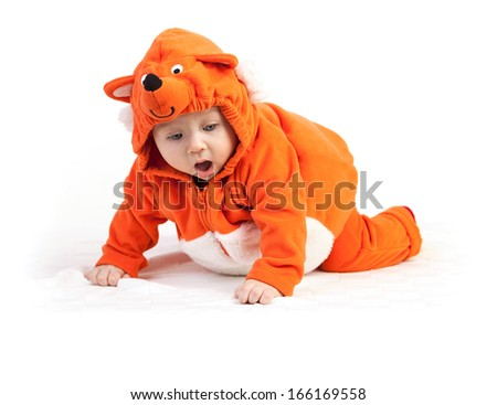 Baby boy in fox costume looking down with surprise over white - stock photo