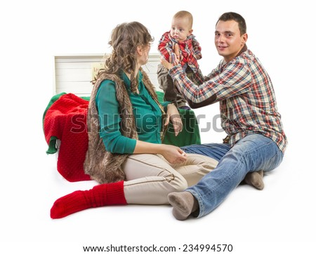 Baby boy in old box with his parents on white background - stock photo