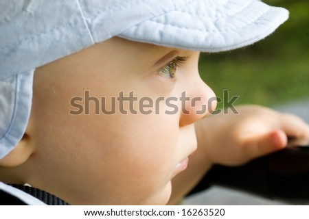 Baby boy in peaked cap