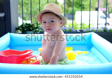 Baby boy in the pool.