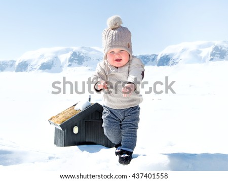 Baby boy in the snow - stock photo