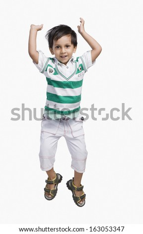 Baby boy jumping and smiling
