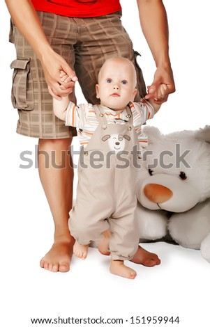 Baby boy learning to walk  - stock photo
